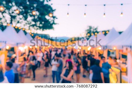 Abstract Blurred image of Night Festival on street  with light bokeh for background usage. (vintage tone) #768087292