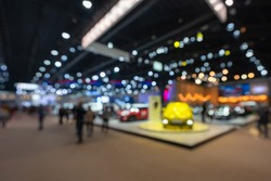 Abstract blurred image of people in cars exhibition show including activities and innovative automotive exhibitions at display in 42th Bangkok International Motor Show 2021 Nonthaburi, Thailand.