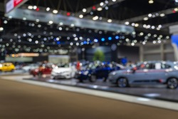 Abstract blurred image of people in cars exhibition show including activities and innovative automotive exhibitions
