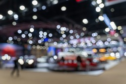 Abstract blurred image of people in cars exhibition show including activities and innovative automotive exhibitions. Blurred for background concept.