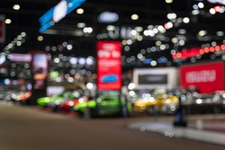 Abstract blurred image of people in cars exhibition show including activities and innovative automotive exhibitions at display in Motor Show 2021 Nonthaburi, Thailand. Concept Blurred for background.