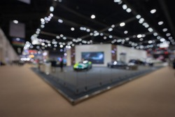 Abstract blurred image of people in cars exhibition show including activities and innovative automotive exhibitions at display. Concept blurred for background.
