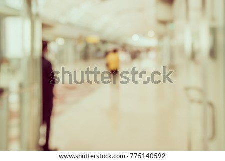 Abstract Blurred image of People walking at airport 's hallway  for background usage.(vintage tone) #775140592