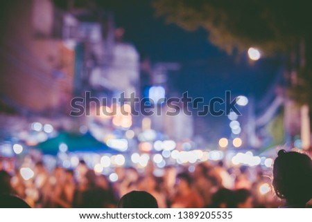 Abstract Blurred image of  people walking in the street at night,bokeh at Walking Street Market,Bokeh background and many people #1389205535