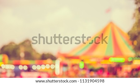 Abstract Blurred image of Theme park on day time with bokeh for background usage . (vintage tone)