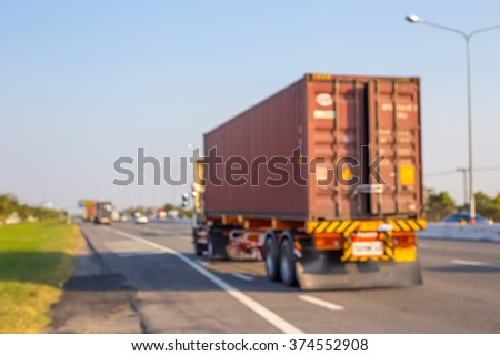 Abstract blurred image of Truck on road. Cargo transportation. #374552908