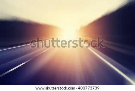 abstract blurred image, sunrise on an empty road