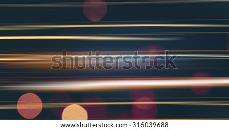 Abstract blurred motion light of the night city auto trafic with bokeh
