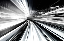 Abstract blurred motion tunnel in blue tinted black and white