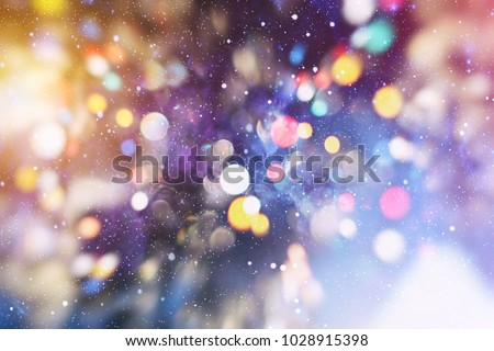 abstract blurred of blue and silver glittering shine bulbs lights background:blur of Christmas wallpaper decorations concept.xmas holiday festival backdrop:sparkle circle lit celebrations display. #1028915398