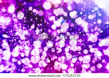 abstract blurred of blue and silver glittering shine bulbs lights background:blur of Christmas wallpaper decorations concept.xmas holiday festival backdrop:sparkle circle lit celebrations display. #575263723