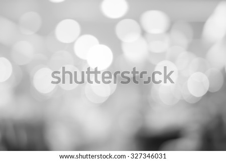 abstract blurred of bokeh light in black and white backgrounds:blurry circle shiny light in gray scale tone colour.image display for design,decorate or etc.