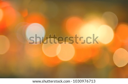 abstract blurred of colorful lights background:blur of Christmas wallpaper decorations concept.backdrop:sparkle circle lit celebrations display.