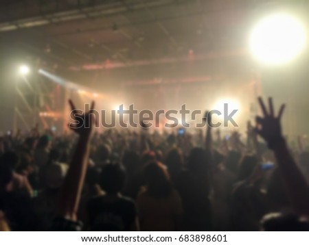 Abstract blurred of concert with hands up having fun #683898601