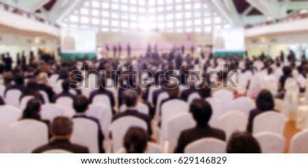 abstract blurred of conference hall or seminar room with audience background. business or education people concept.