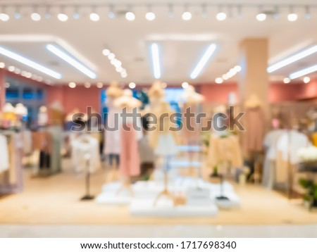 Abstract blurred of fashion clothes shop boutique interior in shopping mall, with bokeh light background. Blurred image of mannequins inside a women fashion store. Stock photo ©