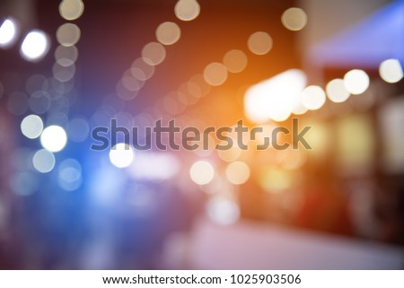 Abstract blurred of festival event with people and motor show background. Convention and Business event concept. People and lifestyle theme. Orange and Blue light tone. Defocused photo #1025903506