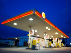 abstract blurred of gas station or petrol station with dark blue sky during twilight time