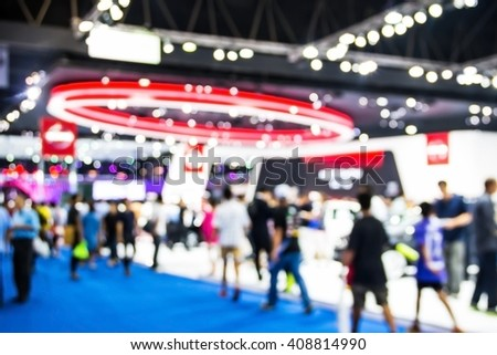abstract blurred of motor  show and  technology exhibition in arena hall.
