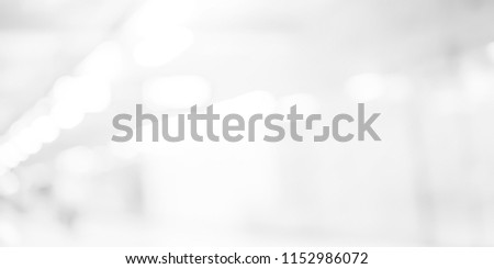 abstract blurred of white silver background of modern contemporary interior office with bokeh light for presentation design concept
