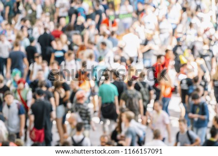 abstract blurred people at a trade fair #1166157091