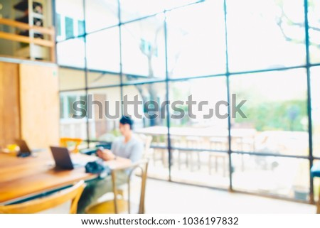 Abstract blurred people in coffee shop background for Ads design #1036197832