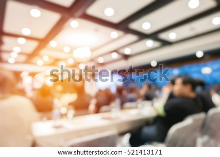 abstract blurred people in seminar or event for background #521413171