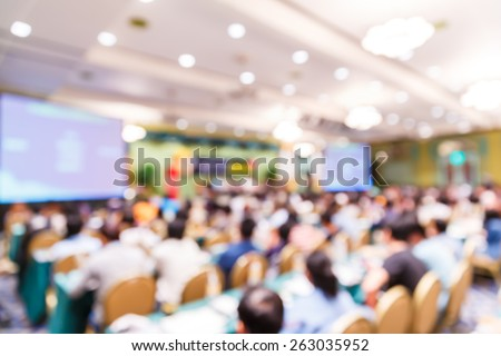 Abstract blurred people lecture in seminar room, education concept