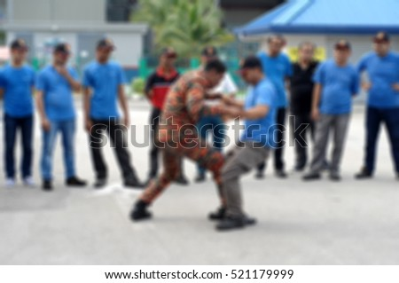 Abstract blurred people practicing how to handle fainted person in annual  fire fighting training course. Safety first. fireman carry or fireman lift  #521179999