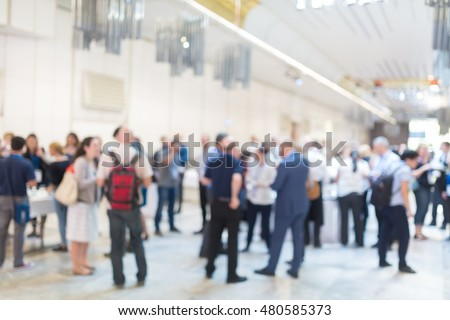 Abstract blurred people socializing during coffee break at business meeting or conference.