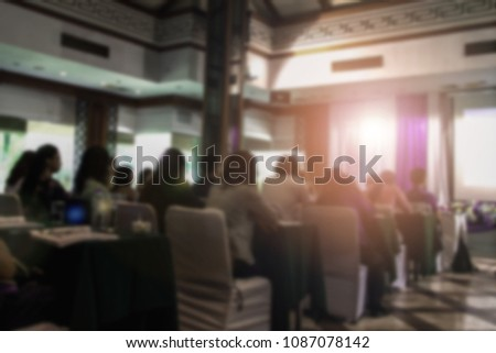 Abstract blurred photo background of business people in conference hall or seminar room. Bokeh business meeting conference training learning coaching concept. #1087078142