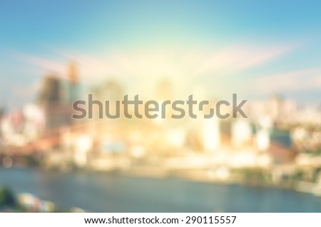 abstract Blurred photo of cityscape with sun background, blur backgrounds concept.