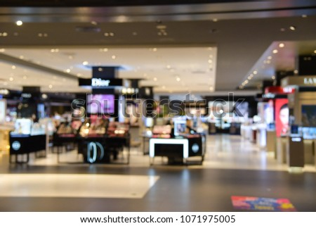Abstract blurred photo of Cosmetic shop counter at department stores #1071975005