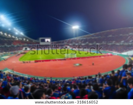 Abstract blurred photo of soccer stadium, sport background concept