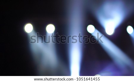 Abstract blurred photo of spotlight in conference hall, seminar and party environment concept #1051641455