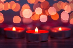 Abstract blurred red candle background