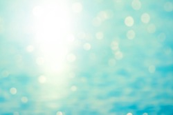 Abstract blurred sea water bokeh against sunlight background. Blur sea water bokeh