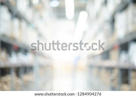 Abstract blurred shopping mall interior background. Blur corridor or aisle of supermarket, grocery store or warehouse for backdrop and design element use. Defocused background with bokeh light.