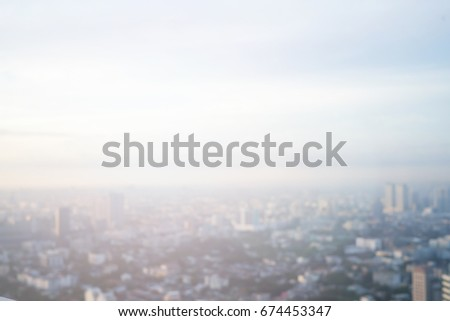 abstract blurred sky morning city building of downtown construction background with lens flare effect. #674453347