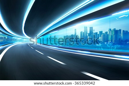 Abstract blurred speed motion road in glass tunnel over the city #365339042