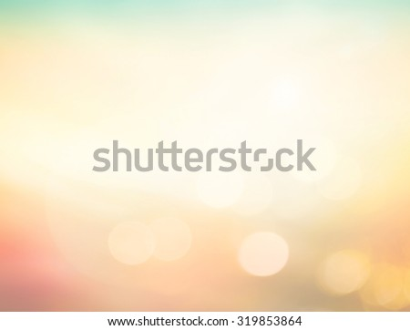 Abstract blurred sunrise over city background with circle bokeh light. Beautiful light of hope from heaven concept. Orange yellow and green colors patterns. Blur backgrounds concept.