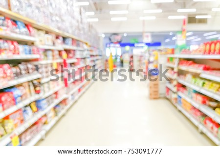 Abstract blurred supermarket aisle with colorful shelves