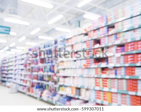 Abstract blurred supermarket aisle with colorful toothpaste shelves and unrecognizable customers as background Foto stock ©