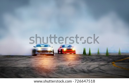Abstract blurred two drift cars with smoke from burned tire