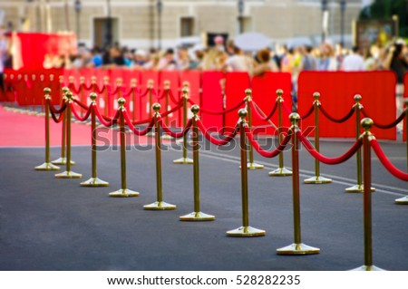 Abstract blurred Way to success on the red carpet (Barrier rope)