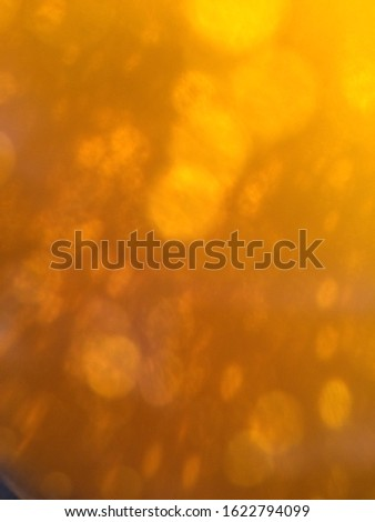 Abstract blurred yellow orange effect background