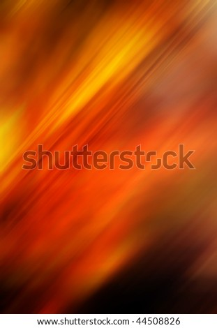 Abstract blurry background in red tones that looks like flames.