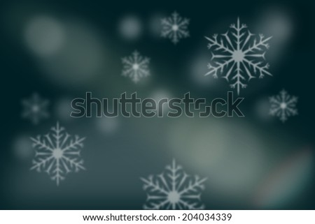Abstract blurry background of snowflakes over blurry snow land