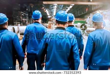 Abstract, blurry, bokeh background, image for the background. People in overalls in production #732352393