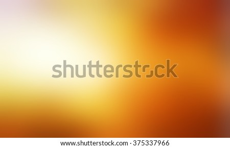 abstract blurry gold background with bright light leak or sunspot flare, abstract smooth textured bright orange brown and gold color, blurred gold background